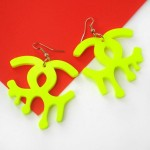 neon_yellow_melting_chanel_logo_dangle_earrings